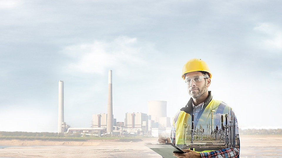 worker in a yellow hard hat transposed onto a background of a power plant
